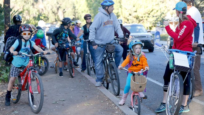 Zack Zbyzenski, left, joins the bike train to Topa Topa Elementary School on Tuesday morning. The Ojai Valley Bicycle Coalition oversees the children riding to school. A lack of bike paths has been an issue in Ojai.