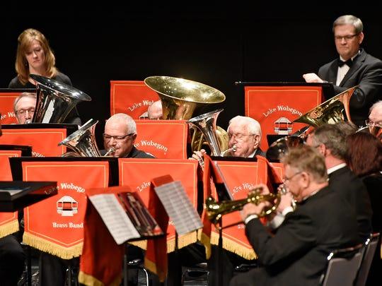 The Lake Wobegon Brass Band members perform Sunday
