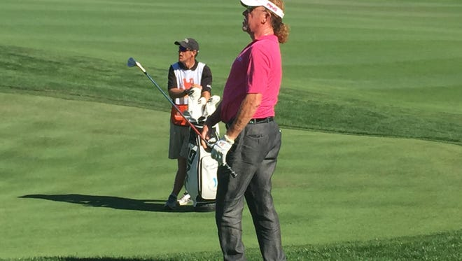 Miguel Angel Jimenez watches an approach shot during Saturday's second round of the Powershares QQQ Championship at Sherwood Country Club in Thousand Oaks.
