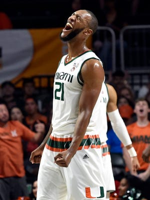 Miami Hurricanes forward Kamari Murphy (21) reacts during the first half against the Clemson Tigers at Watsco Center.