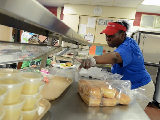 Food service specialist Patrice Foster serves up some
