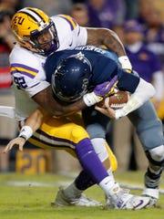 LSU defensive end Neil Farrell Jr. (92) sacks Rice quarterback Shawn Stankavage (3) in the first half of an NCAA college football game in Baton Rouge, La., Saturday, Nov. 17, 2018. (AP Photo/Gerald Herbert)