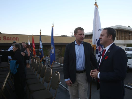 Chad Mayes, at left, speaks with Paul Lewin at the end of the Veterans Day Parade in Palm Springs on November 11, 2015.