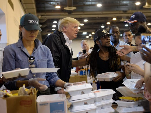 President Trump and Melania Trump pass out food and