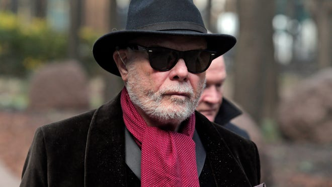 Former British pop star Gary Glitter, whose real name is Paul Gadd, arrives at Southwark Crown Court in London, Wednesday, Jan. 14, 2015. Gadd is due to go on trial over historic sex abuse charges dating back to the 1970s. He is accused of ten charges, with six relating to one girl under the age of 13, two to another girl under the age of 13 and a further two in relation to a girl under the age of 16. (AP Photo/Lefteris Pitarakis)