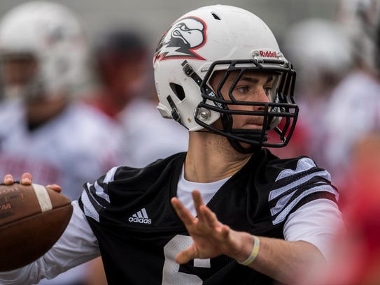 Quarterback Tyler Skidmore throws the ball during the