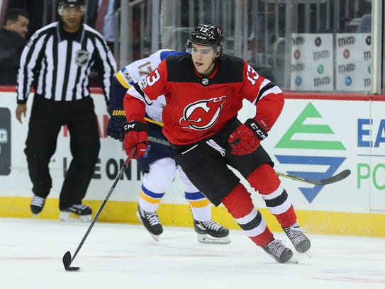 New Jersey Devils center Nico Hischier (13) skates