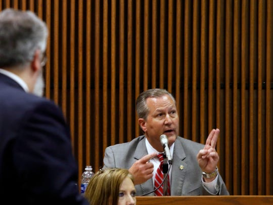 Mike Hubbard answers questions from Deputy Attomey