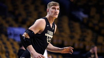 Purdue's Isaac Haas, wearing an arm brace, awaits a pass during practice at the NCAA men's college basketball tournament in Boston, Thursday, March 22, 2018. Purdue faces Texas Tech in a regional semifinal on Friday night. (AP Photo/Charles Krupa)