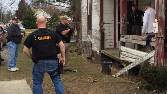 Law enforcement authorities bust a house for drugs Wednesday at 1301 Monnett St., Bucyrus.
