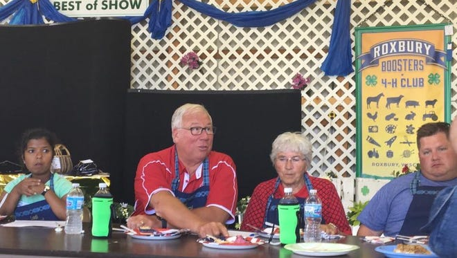Sen. Luther Olsen (R-Ripon) judges the Junior Bake-Off Contest at the Lodi Agricultural Fair on July 8.