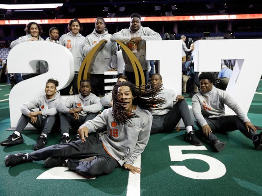 Clemson's Jadar Johnson jumps into a picture during media day for the NCAA college football playoff championship game against Alabama Saturday, Jan. 7, 2017, in Tampa, Fla. (AP Photo/Chris O'Meara)