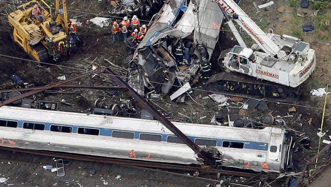 Emergency personnel work at the scene of a deadly train wreck, May 13, 2015, in Philadelphia.