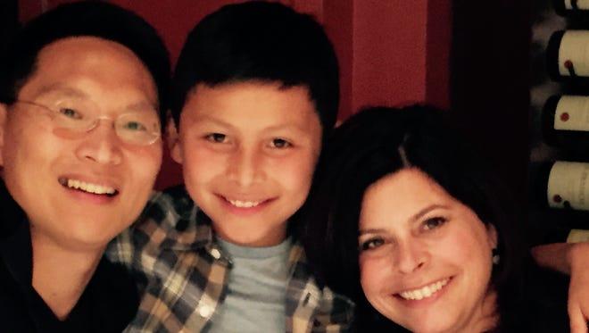 Milton and Sarah Hwang and their son, Ethan.