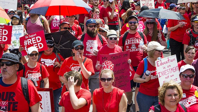Thousands march west on Washington toward the Capitol in Phoenix during the #RedForEd teacher walkout on Thursday, April 26, 2018,