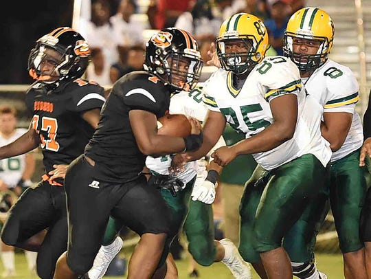 Opelousas High running back Kenny Frazier (1) tries