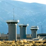 In this Feb. 21, 2007, file photo, guard towers loom over the administrative maximum security federal prison called Supermax near Florence, Colo. Senior U.S. officials say Friday, Oct. 2,2015, that a Defense Department team will be visiting Colorado State Penitentiary in Canon City and the so-called Supermax federal prison in Florence to assess their possible use to house detainees from Guantanamo Bay, Cuba, as part of the Obama administration's plan to close that detention center. (Chris McLean(/The Pueblo Chieftain via AP) MANDATORY CREDIT