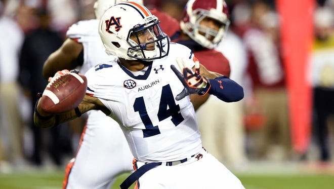 Auburn Tigers quarterback Nick Marshall throws a touchdown pass on Nov. 29.