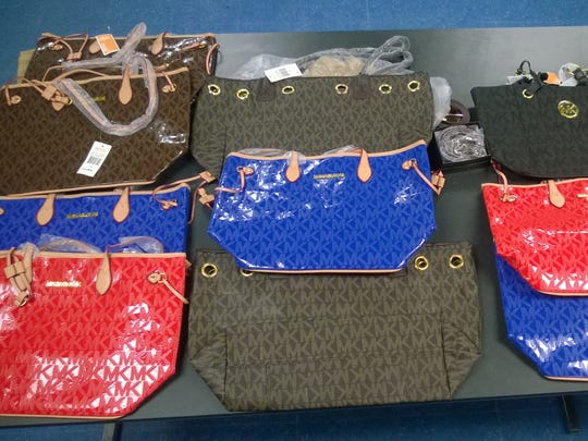 Gerardo H. Mattiaccio is accused of selling counterfeit Michael Kors and Louis Vuitton items to a Stony Point gas station.