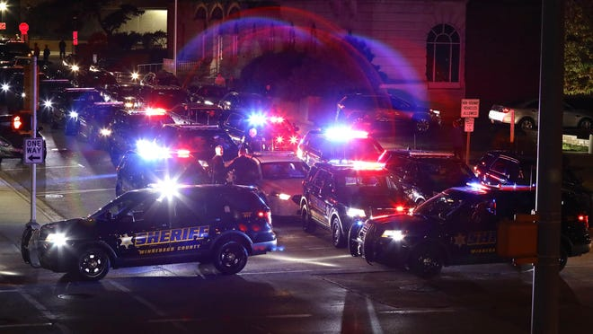 A police procession escorts the body of Winnebago County Sheriff's Department Deputy Chief Donald Gasparini Jr. across Rockford on Tuesday, Oct. 13, 2020. Gasparini died while off duty Sunday. He was 46.
