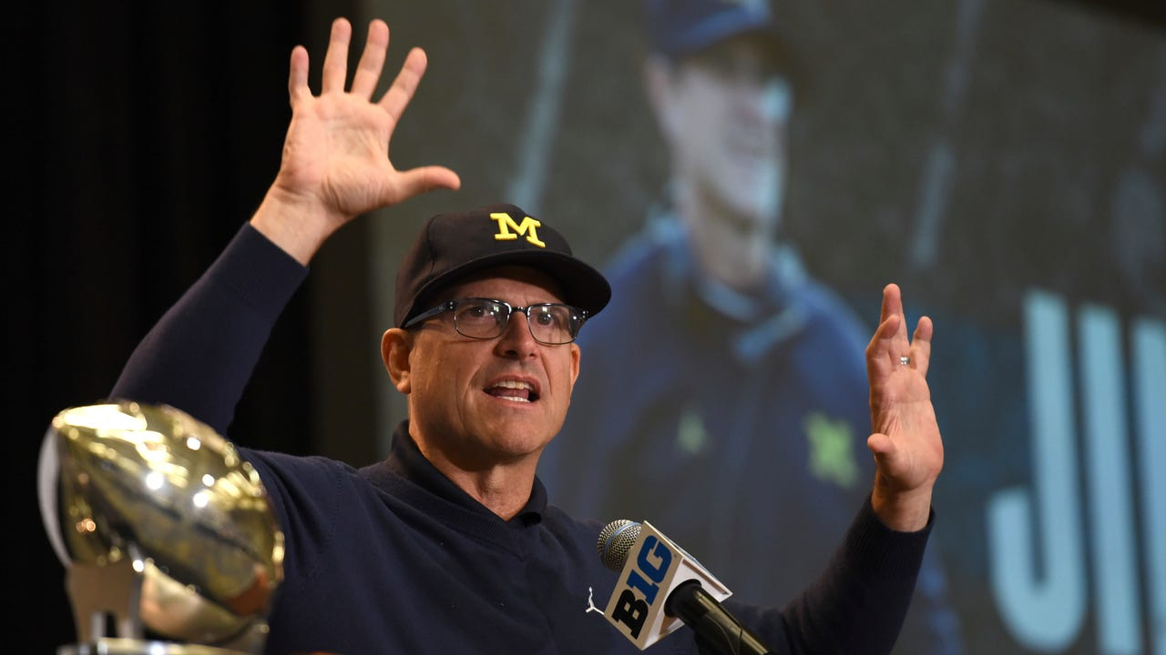 "Jim Harbaugh was asked if Michigan is under the radar heading into the season. ""I don't know,"" he said. ""We're just going to work on Monday (when practice starts)."""