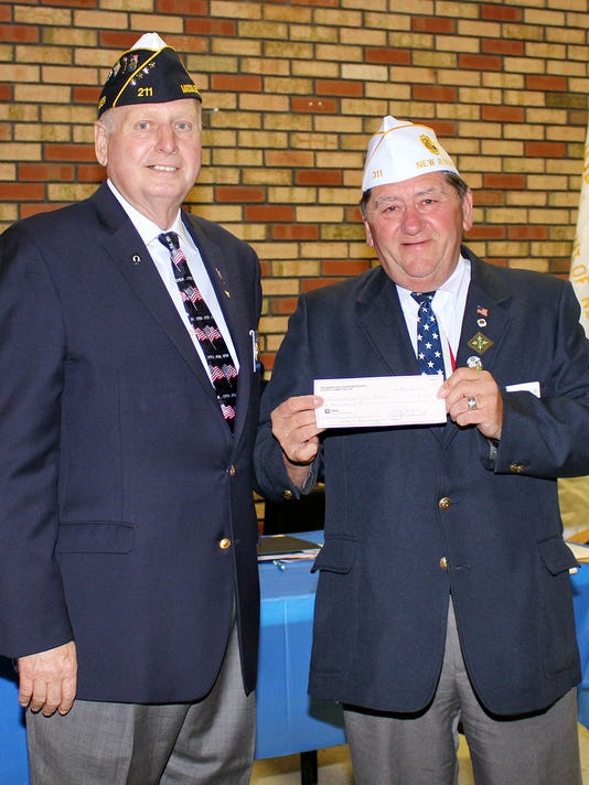 635761773876505313-Larry-Bishop-presents-county-donation-to-Mike-Babli