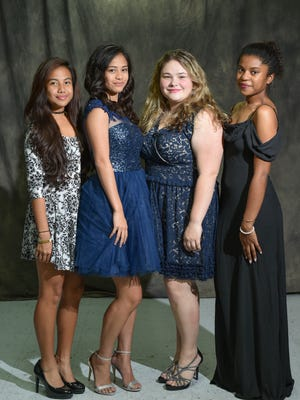 From left, Vibesters Lovely Sejalbo, Hanna Sahagon, Anelyse Morris, and Danielle Stephenson, model different looks for this year's prom.