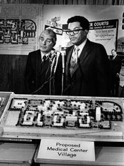 From left, Edwin H. Homer and Nicholas Hood with a mock up of the proposed  Medical Center Village in 1972.