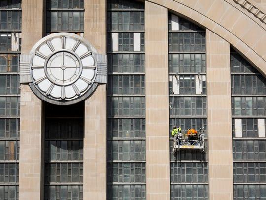 Construction crews work on restoring the Cincinnati