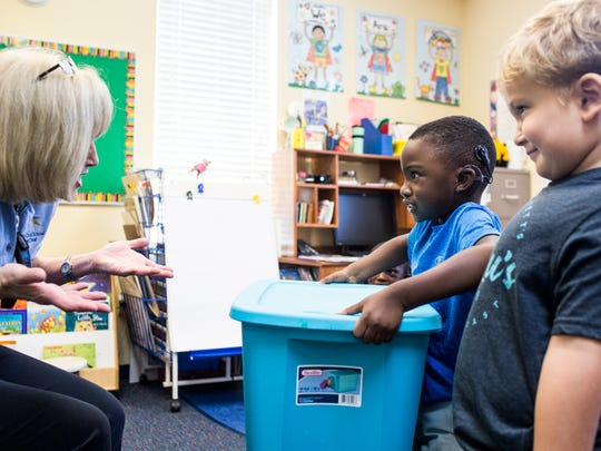 July 12, 2018 - Jamari Dowdy, 4, lifts a box after being asked if it was light or heavy during an exercise in Cyndi Eaton's classroom at the Memphis Oral School for the Deaf in Germantown. Memphis Oral School for the Deaf has new leadership in Executive Director Lauren Hays and Principal Shannon Hall.