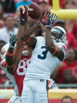 Auburn defensive back Jonathan Jones (3) deflects a pass intended for Wisconsin wide receiver Alex Erickson (86) during the Outback Bowl between Auburn and Wisconsin at Raymond James Stadium in Tampa, Fla., on Thursday, Jan. 1, 2015.
