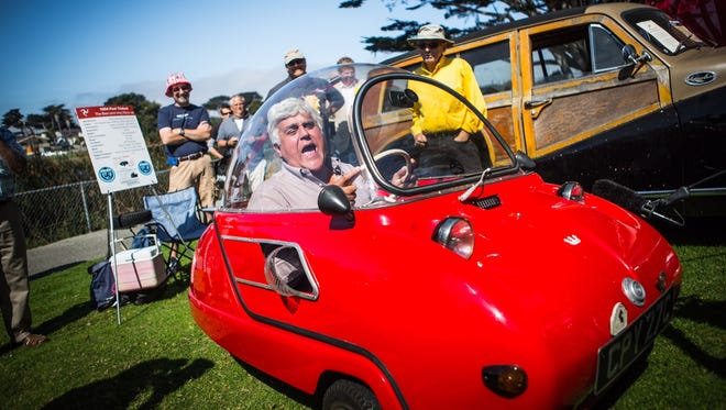 """Jay Leno clowns around at the recent Pebble Beach Concours d'Elegance for his CNBC special, """"Jay Leno's Garage: Ultimate Car Week."""""""