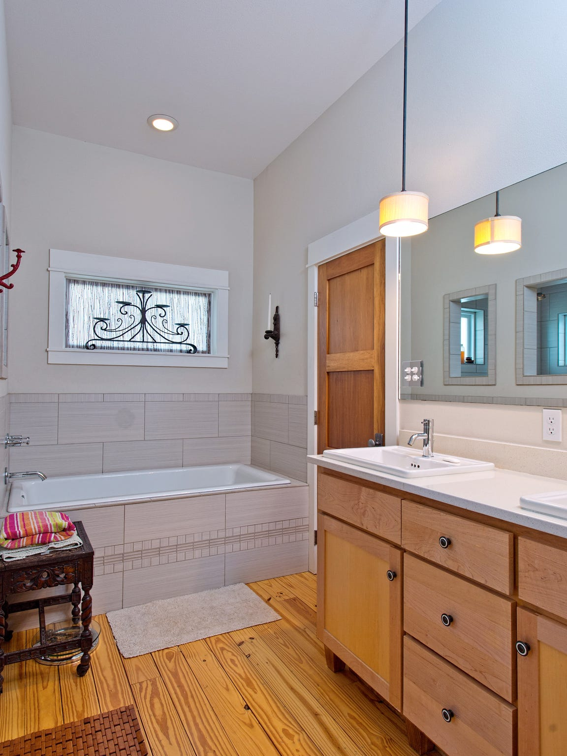 The master bath features pine plank floors, double vanities, a nice soaking tub and large walk in shower