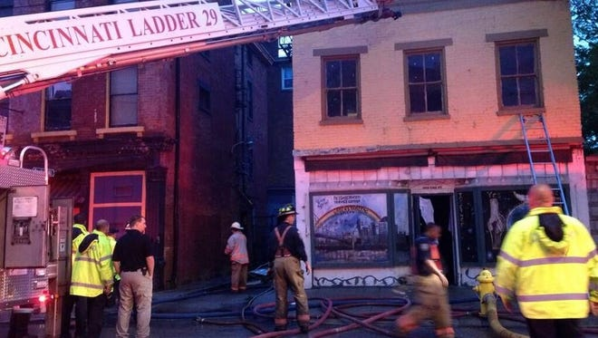 Cincinnati Fire Department crews extinguished a fire in Over-the-Rhine Monday night that damaged two vacant buildings.