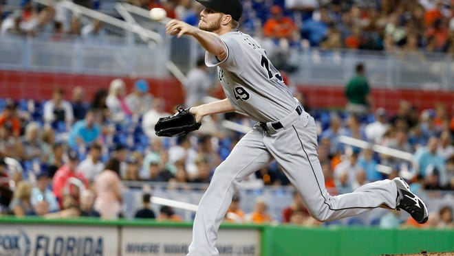 Chicago White Sox's Chris Sale delivers a pitch during the first inning of a baseball game against the Miami Marlins, Sunday, Aug. 14, 2016, in Miami. (AP Photo/Wilfredo Lee)