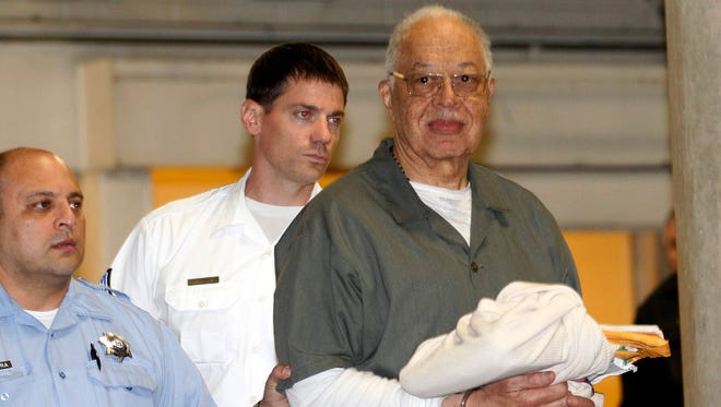 Kermit Gosnell is escorted to a waiting police van in Philadelphia last year after he was convicted.