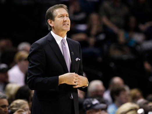 Suns head coach Jeff Hornacek watches from the sideline during the first half against the Suns  at AT&T Center.