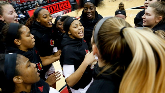 Louisville's Arica Carter, center, gets the team pumped up before the game against SEMO.