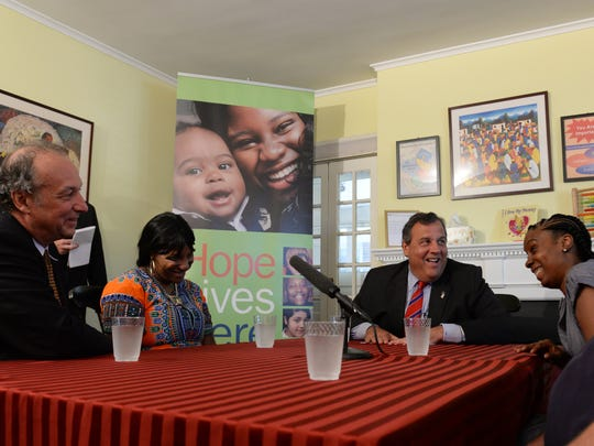 Gov. Chris Christie speaks Thursday with people who have benefited from the Keeping Families Together program. With him are, from left, Jacques Hryshko, executive director of Family Connections; Elisha Blackmon of Jersey City, and Nakisha Dollar of Paterson.