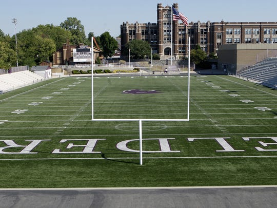 "Elder Stadium, or as it's commonly known, ""The Pit."" The football stadium, designed by students and built by community members, is a cement horseshoe-shaped structure that seats 10,000. Photos taken at Elder High School, 3900 Vincent Avenue, on September 1, 2010."