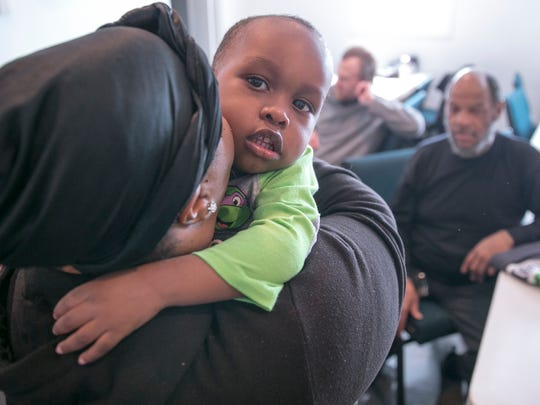 Amier Williams, one-year-old, gets a hug from his aunt Tiffany Harwell, at Temple of Believers Deliverance Church, Indianapolis, Saturday, March 3, 2018. The church offers a no cost breakfast, aimed as an aid to community members who could use a hot meal, coupled with a short sermon at 11am on Saturday mornings.