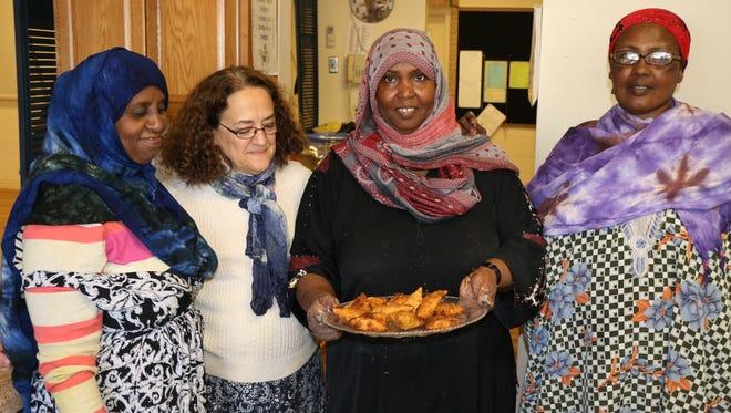 From left, Sadiya Omar, Sharon Silvio, Saynab Mohamed and Safi Osman make sambusas in the kitchen of the Somali Community in Western New York at the Greek Orthodox Church of the Holy Spirit, 835 South Ave.