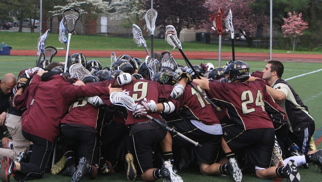 Iona defeated John Jay 9-8 in a boys lacrosse game at John Jay High School in Cross River May 9, 2013. ( Frank Becerra Jr / The Journal News )