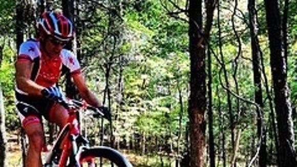 Mountain biker rides the rock garden at the Ridgeland Trails.