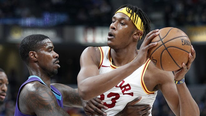 Indiana Pacers center Myles Turner (33) attempts to drives on Charlotte Hornets forward Marvin Williams (2) in the first half of their game at Bankers Life Fieldhouse on Tuesday, April 10, 2018.