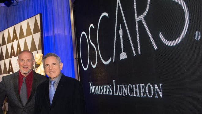 Producers Neil Meron, left, and Craig Zadan attend the 86th Academy Awards nominee luncheon. Meron and Zadan are returning for their second year as Oscar ceremony producers.