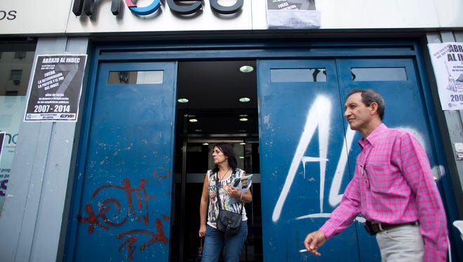 People walk by the entrance of the headquarters of the National Institute of Statistics and Censuses (INDEC) in Buenos Aires on Feb. 13.