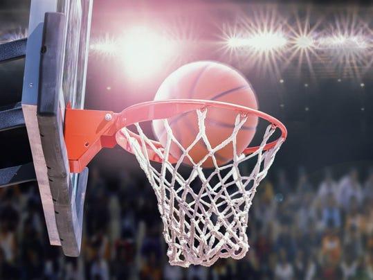 basketball scoring during match in arena