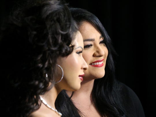 Suzette Quintanilla Arriaga stands next to the Selena