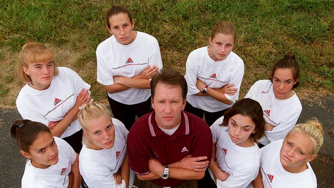 The Colerain High School girls cross country team is going for the third straight state title with from the left front, Alison Zeinner, Kelly Crum, coach Ron Russo, Alison Bedingfield, Catie Grebe, back from left, JenniferLimle, Terie Littlepage, Shelly Dickinson and and Lori Siconolfi.